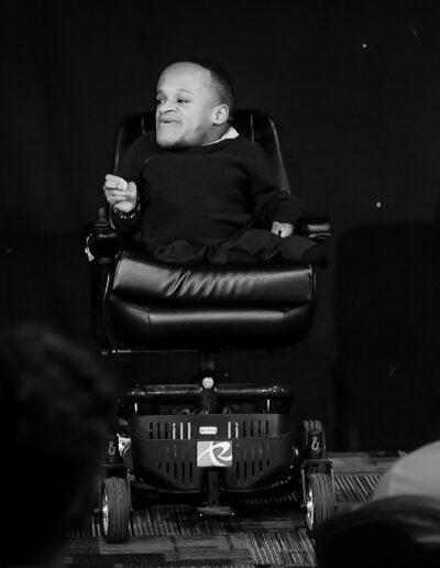 Winston speaking on stage